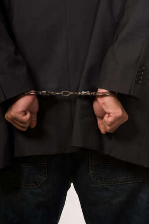 Male fisted hands up close in hand cuffs Stock Photo - 3905891