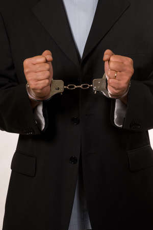 cuffs: Male fisted hands up close in hand cuffs Stock Photo