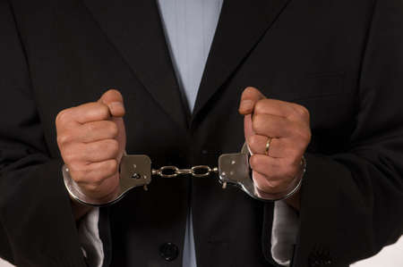 Male fisted hands up close in hand cuffs Stock Photo - 3917608