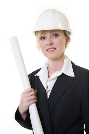 Attractive blond woman in business suit wearing a white safety hard hat holding onto long white rolled up plans photo