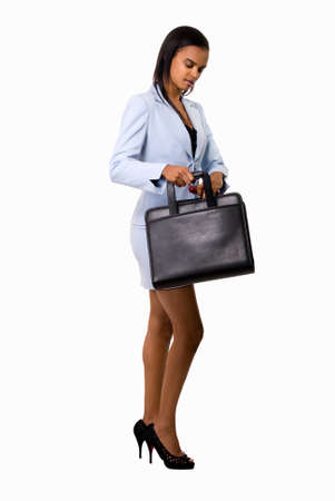 Full body of an Attractive African american woman wearing light blue business suit with skirt carrying a black briefcase over white photo