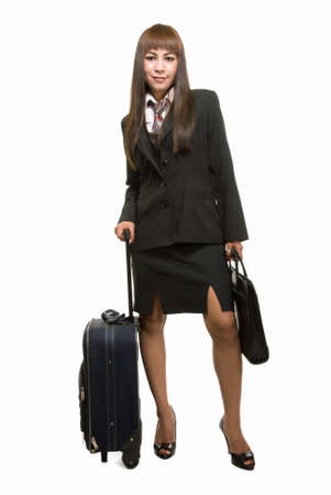 Full body of Asian woman in black business suit skirt with suitcase standing over white background photo