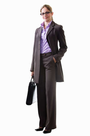 Full body of an attractive blond woman wearing grey business pant suit with hair tied up and eyeglasses over white