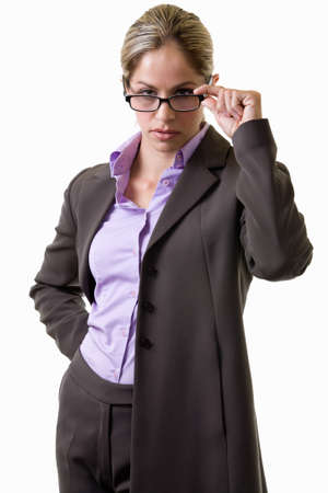 Blond woman in professional business suit holding on and looking over eyeglasses with a stern look