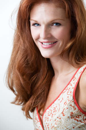 long red hair woman: Close up of beautiful long red hair woman with blue eyes smiling