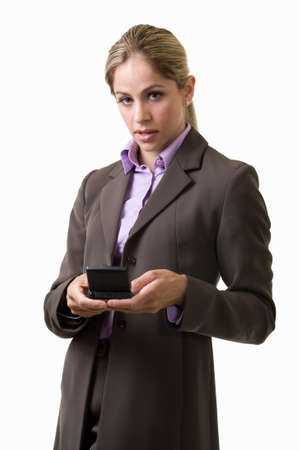 pager: Attractive blond woman dressed in grey business suit standing on white background looking down and typing on a pager
