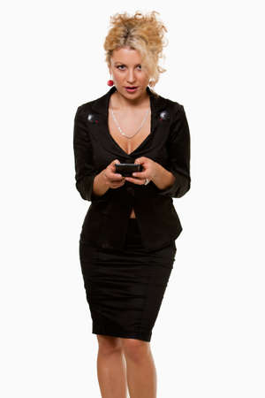 pager: Attractive blond business woman wearing business suit holding and typing on a pager