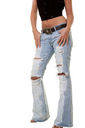 ripped: Legs of a woman wearing ripped faded jeans standing over white Stock Photo
