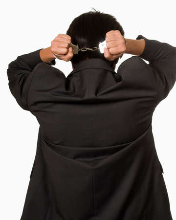 Back view of man with hands behind back in handcuffs Stock Photo - 4676525