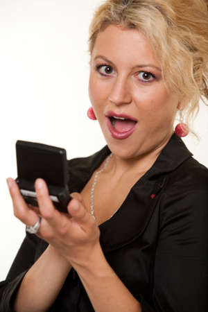 pager: Attractive woman with blond curly hair up close holding a pager open with a surprised expression