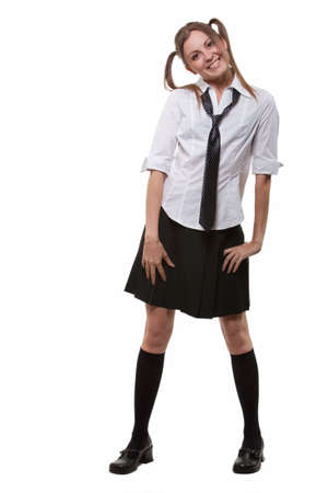 unifrom: Full body of an attractive woman with brown hair in ponytails wearing school unifrom skirt white blouse and tie Stock Photo