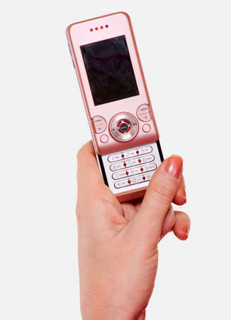 Close up of a womans hand holding up and open pink cellular telephone over white photo