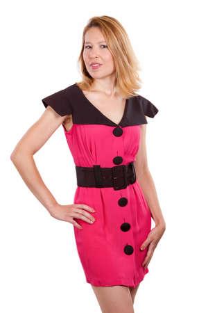 Atractiva mujer rubia caliente usando vestido rosa con negro sobre blanco los botones de pie Foto de archivo - 4941627