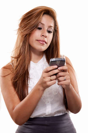 pager: Attractive brunette hispanic business woman in her twenties Stock Photo