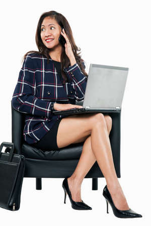 telecommuter: Young attractive confident asian businesswoman in her thirties