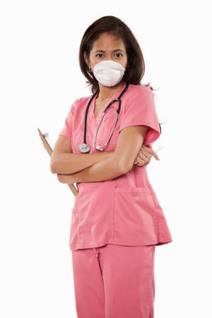 medical doctors: Attractive thirties asian woman doctor nurse wearing facemask Stock Photo