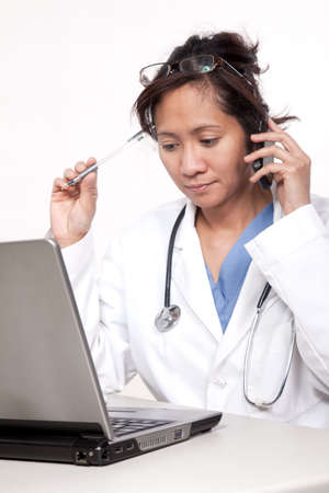 Asian doctor physician working with technology