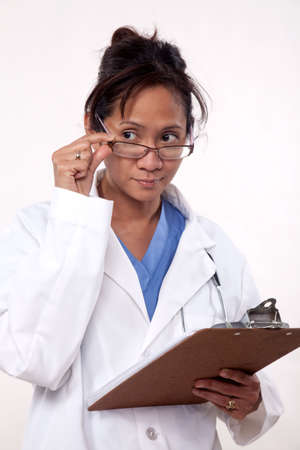 Asian doctor physician carrying patient chart