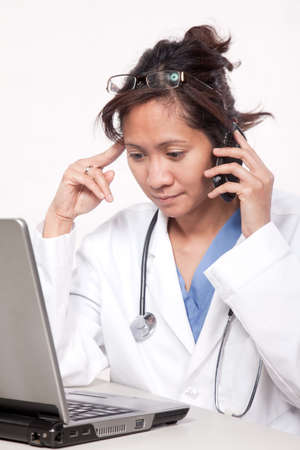 Asian doctor physician working with technology photo