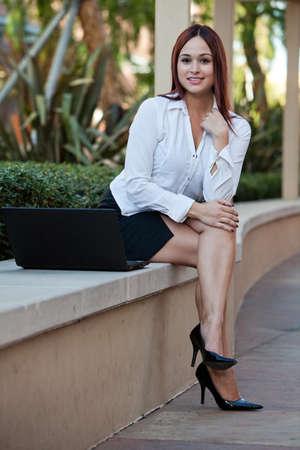 Pretty twenties native american businesswoman working with laptop 스톡 콘텐츠