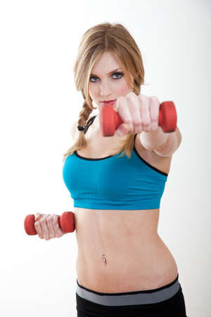 navel piercing: Beautiful blond caucasian woman exercising