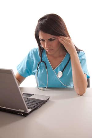 paramedical: Pretty hispanic twenties healthcare worker Stock Photo