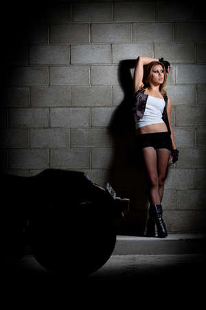 Beautiful twenties caucasian fashion woman with motorcycle