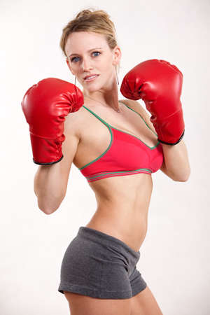 Attractive caucasian thirties woman boxing photo