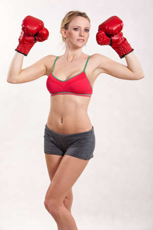 30s: Attractive caucasian thirties woman boxing