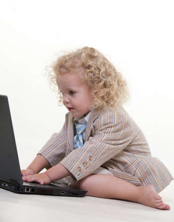 Cute little jewish boy playing with laptop Stock Photo - 12063336
