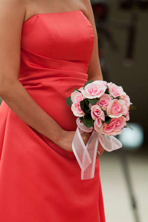 Bridesmaids bouquet of flowers in wedding photo