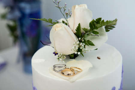 topper: Wedding cake and topper with rings Stock Photo