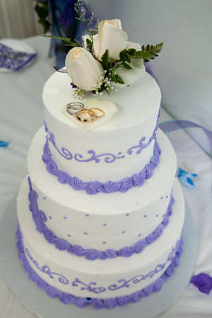 Wedding cake and topper with rings photo