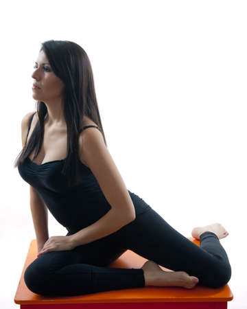 Attractive twenties hispanic woman doing yoga exercise Stock Photo - 12068336