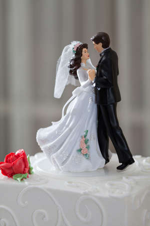 Wedding cake and topper with couple dancing photo
