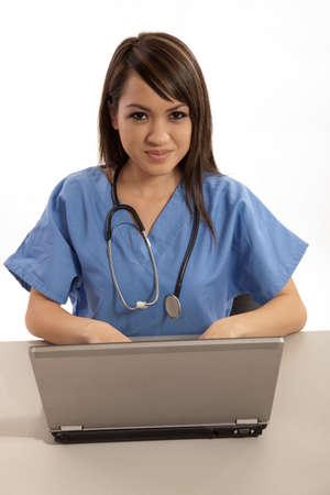 laptop: Filipino nurse doctor working on laptop computer