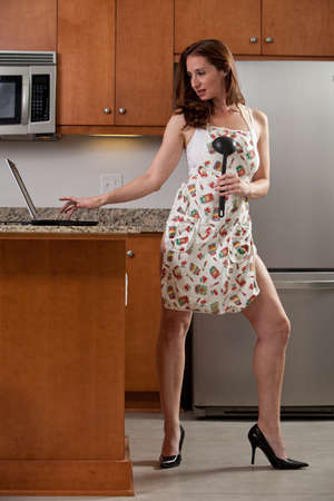 Attractive thirties caucasian woman working on kitchen