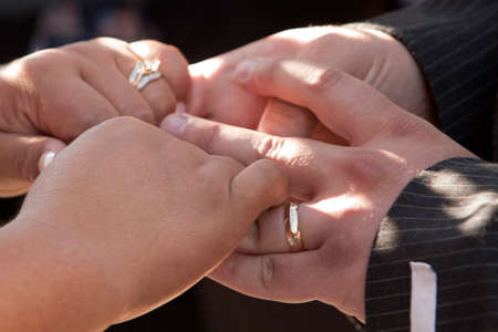 wedding vows: Hands of Bride and Groom in wedding vows