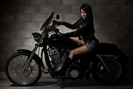 sexy asian woman: Sexy attractive twenties asian woman sitting on motorcycle
