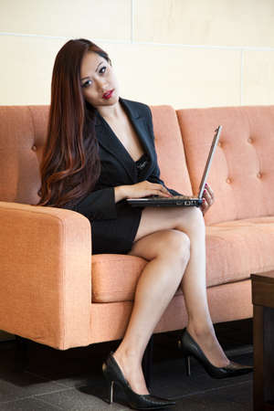 couches: Pretty 20s asian vietnamese businesswoman