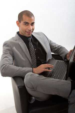 african businessman: Young african american black businessman in suit