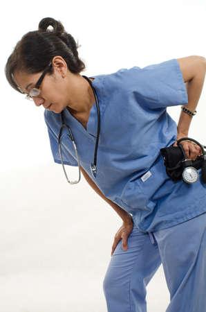 mujeres de espalda: Confident asian enfermera profesional m�dico Foto de archivo