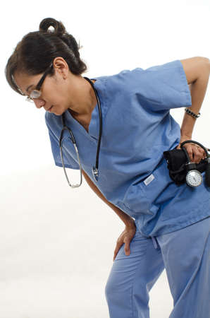 woman back pain: Confident asian nurse doctor medical professional Stock Photo