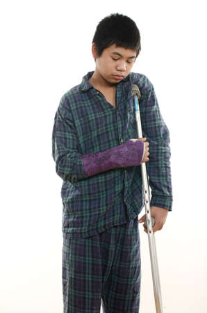 lame: Young asian american boy with broken arm Stock Photo