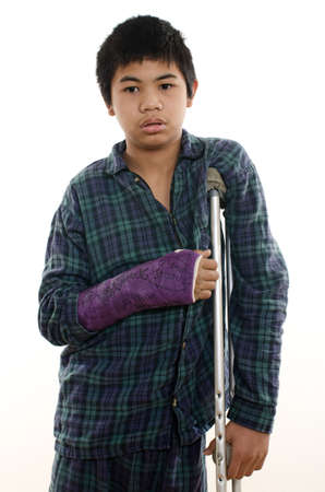 cast: Young asian american boy with broken arm Stock Photo