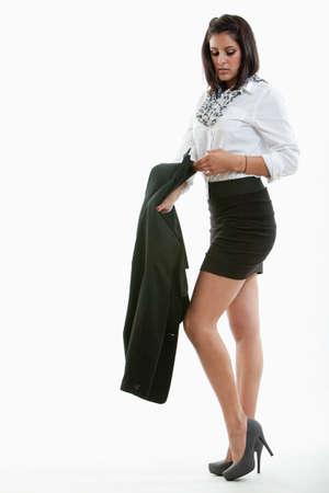 girl undressing: Attractive hispanic twenties businesswoman