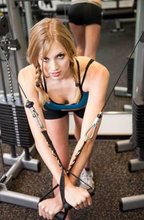muscle toning: Young pretty caucasian woman exercising Stock Photo