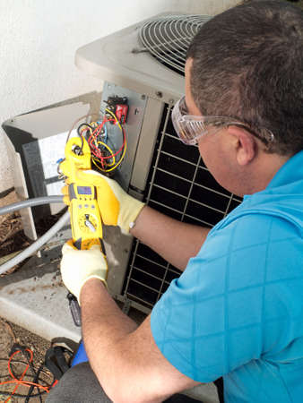 air conditioning: Male hispanic air-conditioning maintenance technician