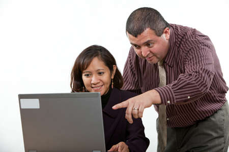 computer training: Attractive multi ethnic business man and woman team