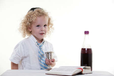 Young curly haired jewish caucasian toddler boy photo